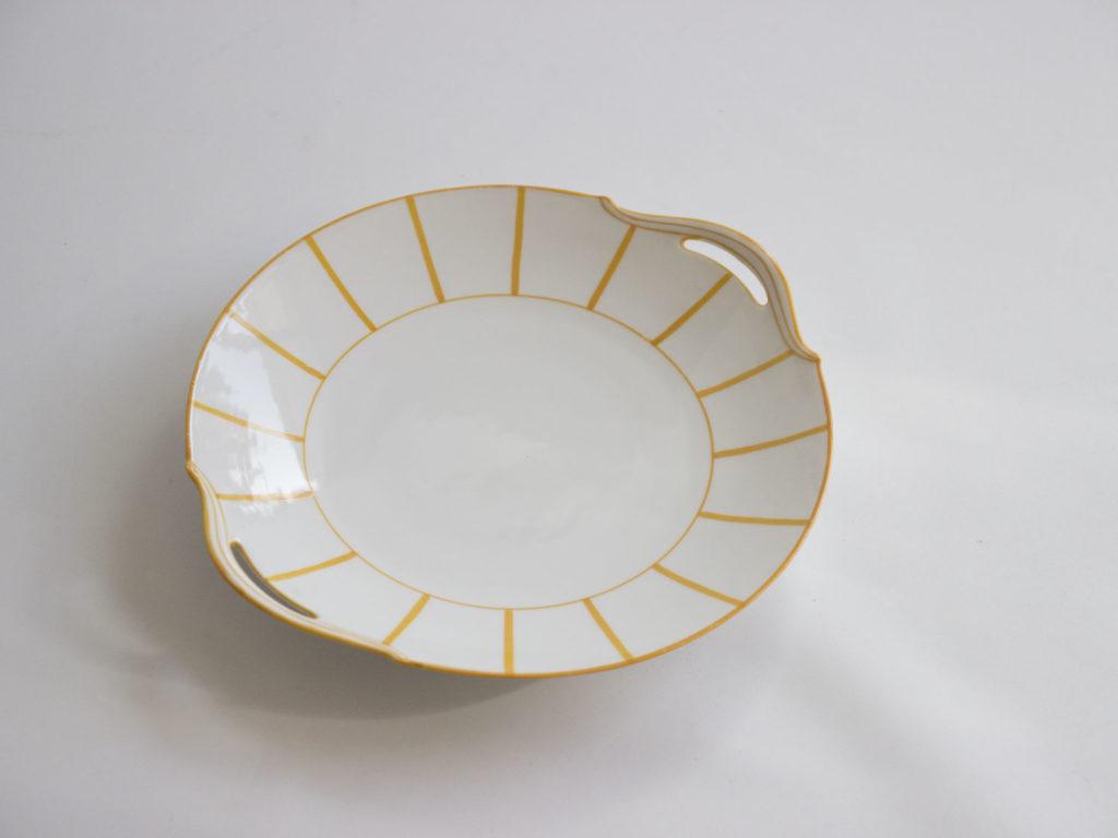 Plat jaune en porcelaine de Limoges