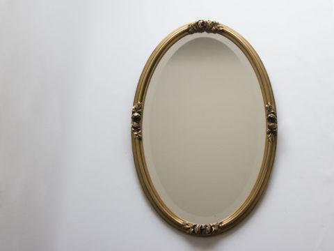 Miroir doré ovale
